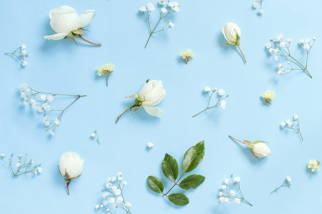 Flowers on a light blue background top view