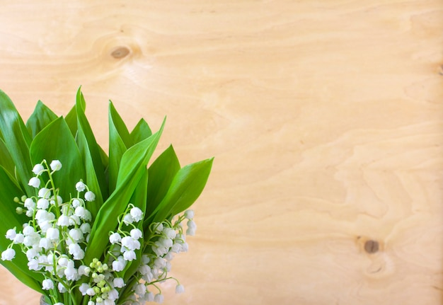 Flowers lily of the valley spring wooden surface