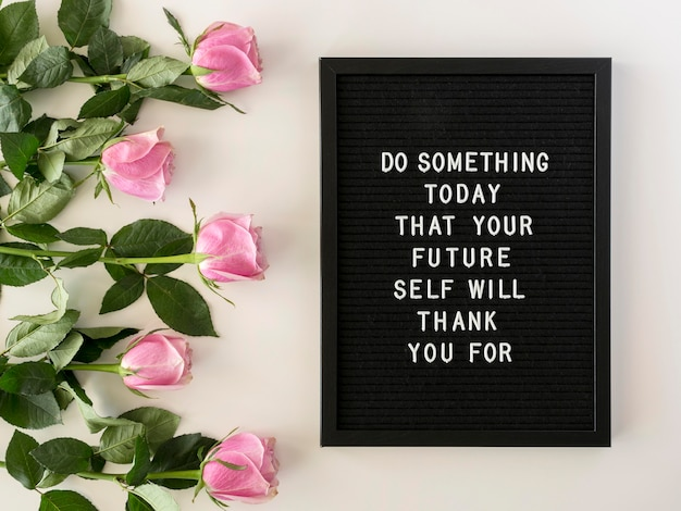 Flowers and motivational text arrangement