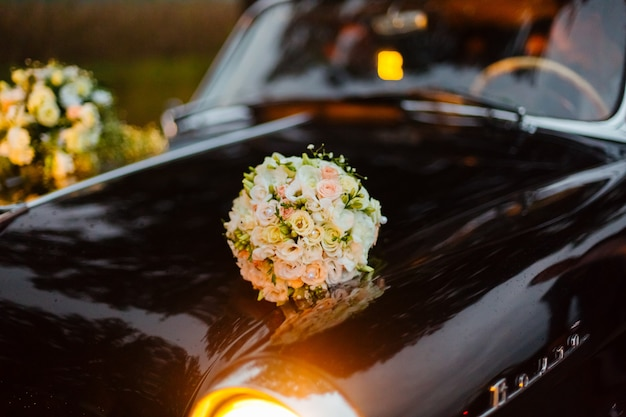 Flowers on an old retro car