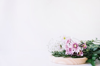 Flowers on wooden plate