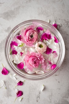 Flowers petals in bowl on table
