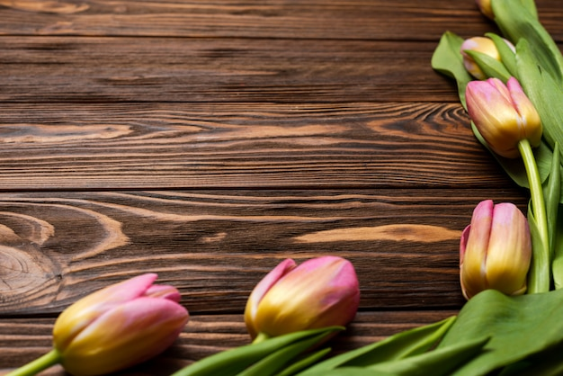 Flowers of spring tulips on the wooden boards of the table. greeting card for mother's day, easter. copy space