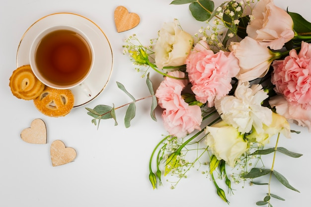 Flowers and tea in flat lay