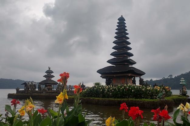 Flowers and ulun danu temple beratan lake in bali indonesia