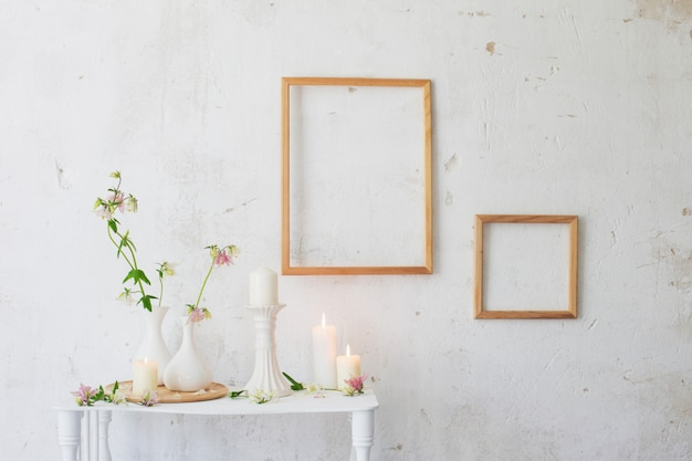 Flowers in vase and frames on the wall