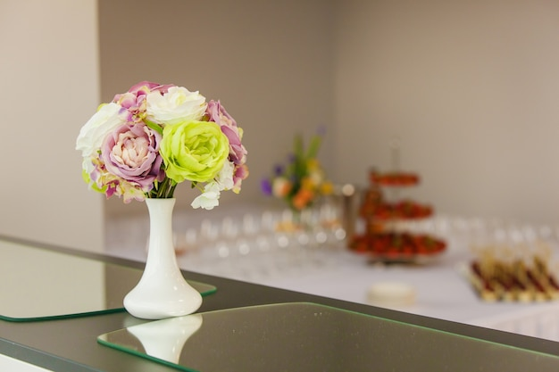 Flowers in the vase on the table, decor for the event
