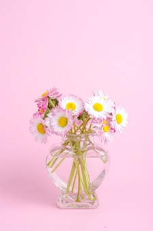 Flowers in a vase with shape of heart