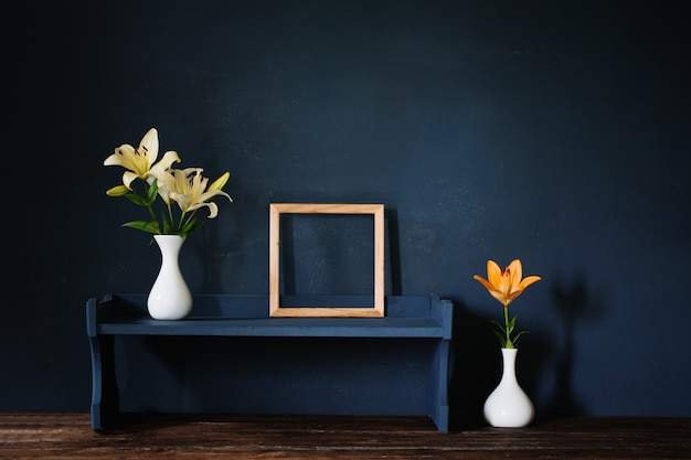 Flowers in vase and wooden frame