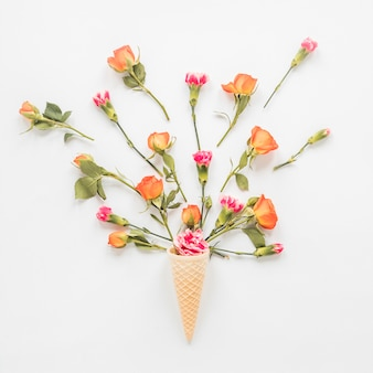 Flowers in waffle cone on table