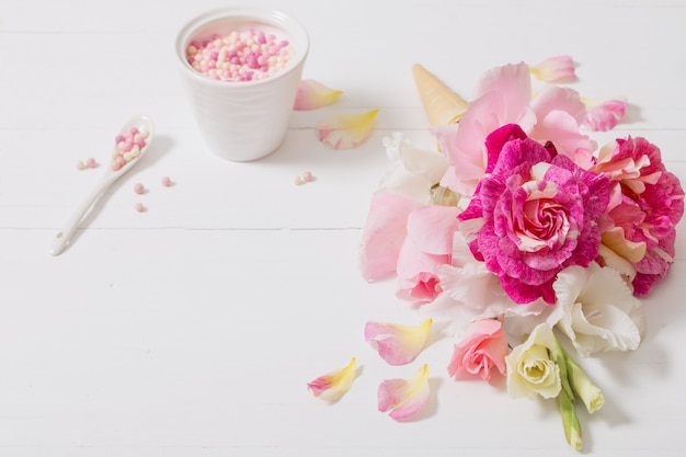 Flowers in waffle cone on wooden background