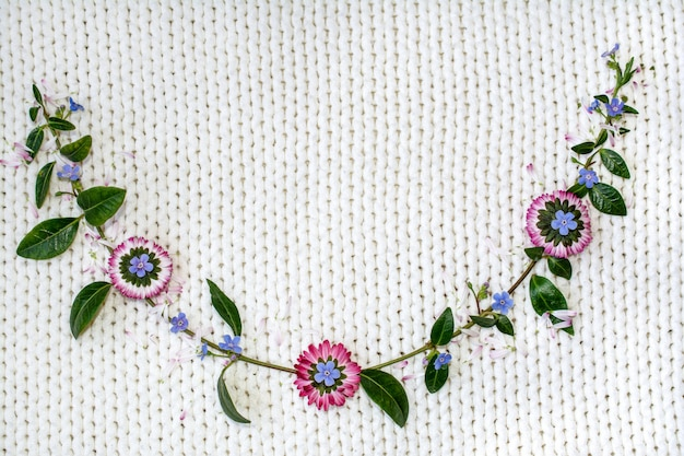 Flowers on a white background of knitted fabric.