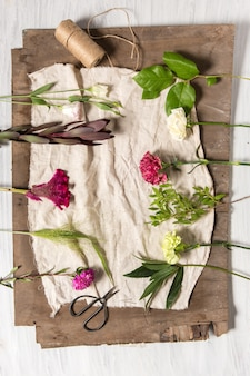 Flowers on white wooden table