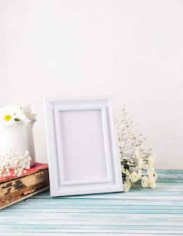 Flowers with blank frame and book