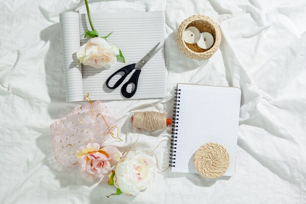 Flowers with empty vintage notebook