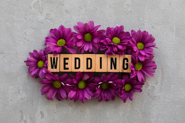 Flowers with wooden wedding sign