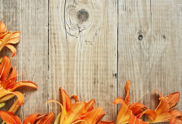 Flowers on a wooden background