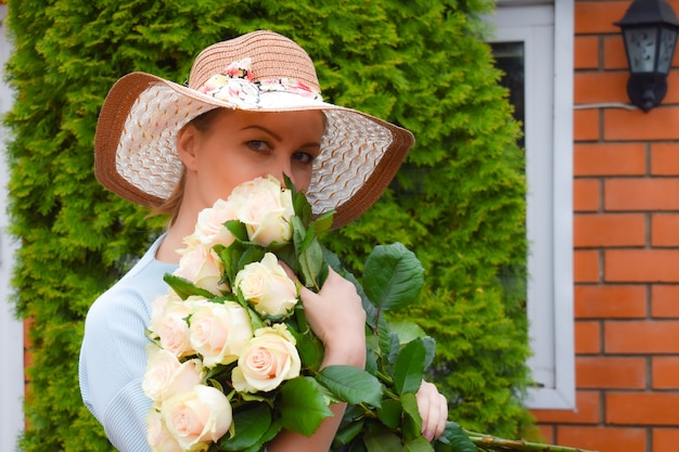 Flowers for you. beautiful lady with bouquet of delicate roses.