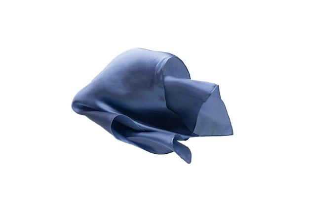 白い背景で隔離の流れる青いシルクスカーフ。