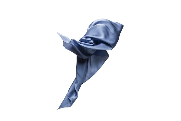 Flowing blue silk scarf isolated on white.