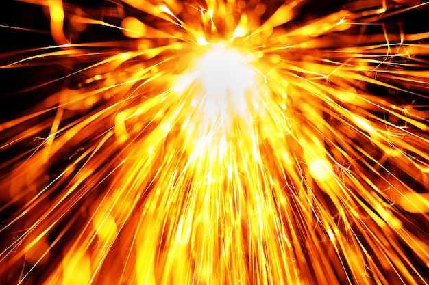 流れる火花、色付きの写真、抽象的な表面
