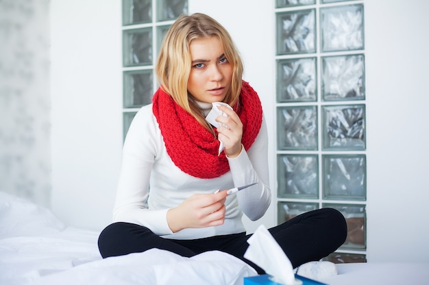 Flu and sick woman. sick woman using paper tissue, head cold problem.