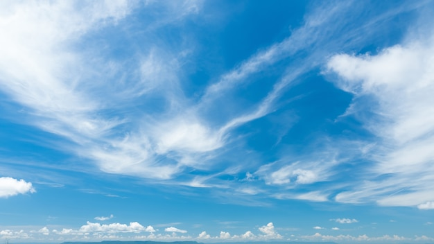 Fluffy cirrus clouds on blue blue sky