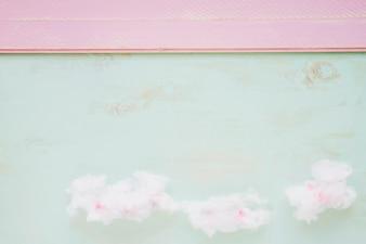 Fluffy cloud against color texture backdrop