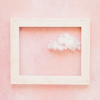 Fluffy cloud in frame outline against painted wall