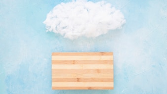 Fluffy cloud over the wooden table