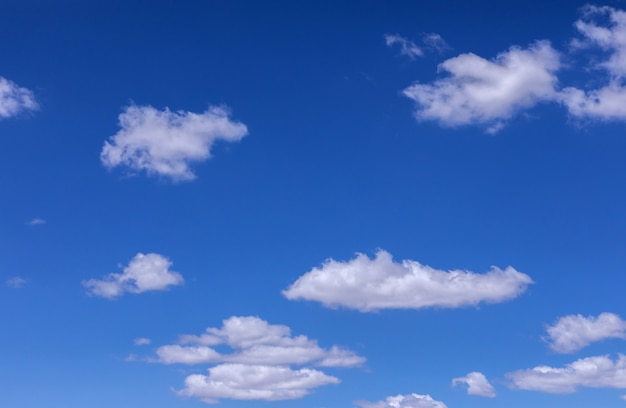 Fluffy clouds on beautiful blue sky