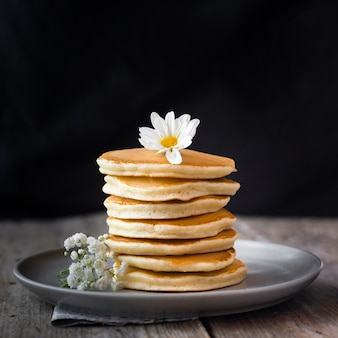 Fluffy pancakes tower on plate