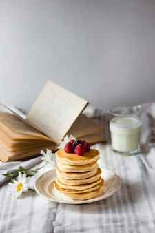 Fluffy pancakes tower with forest fruit