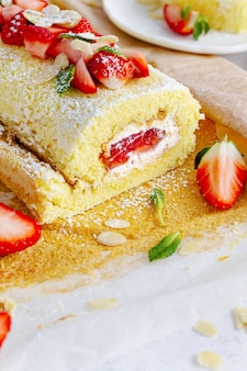 Fluffy strawberry swiss roll food photography