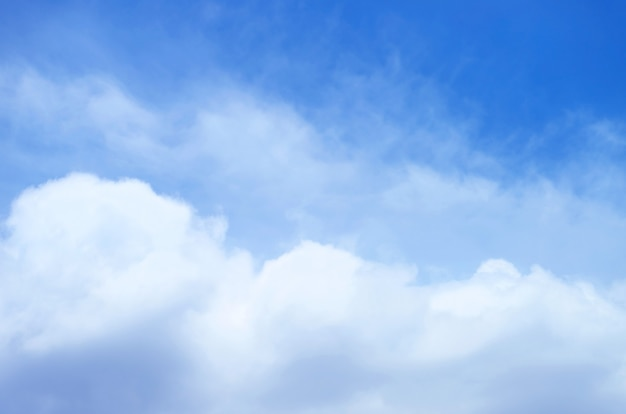 Fluffy white cumulus clouds on vibrant blue sky