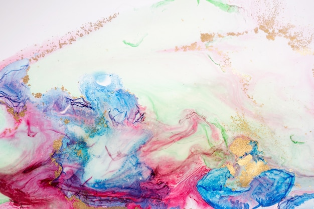 Fluid art abstract light blue and pink ink background.