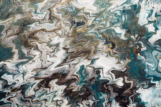 Жидкое искусство. абстрактный волнистый фон или текстура. белые и синие зигзагообразные линии с золотыми частицами.