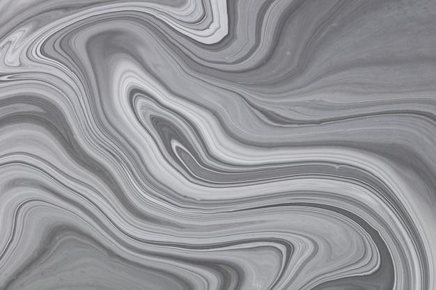 流動的なアートテクスチャ。虹色のペイント効果のある抽象的な背景