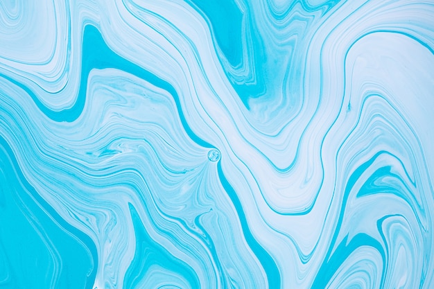 Fluid art texture abstract background with swirling paint effect liquid acrylic picture with flows and splashes mixed paints for posters or wallpapers blue mint and white overflowing colors