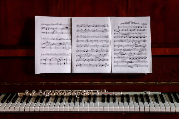 Flute on piano keys, wind instrument for musical design of concert creativity