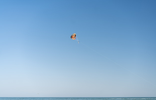 Fly with colorful parachute at the beach