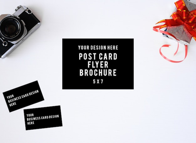 Flyer brochure post card with old film camera and lenses flat lay