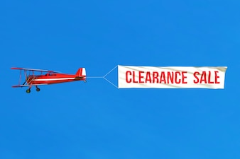 Flying airplane and Sale banner on blue sky.