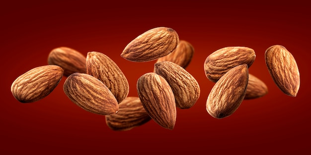 Flying almond isolated on red