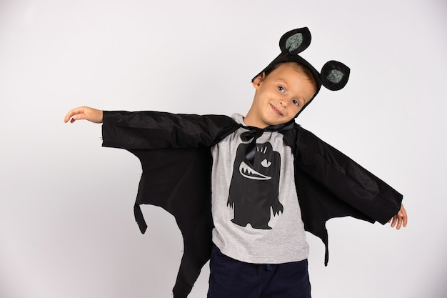 Flying bat boy. boo carnival costume . cute scary spooky character. smiling face with open hands. .