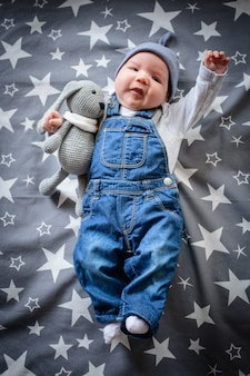 Flying child in the starry sky. funny baby on a blue starry background
