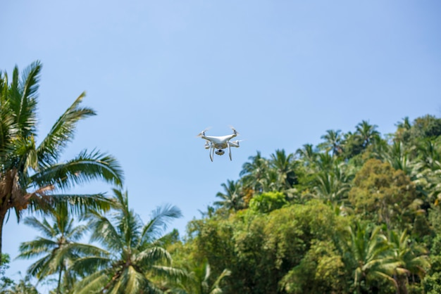 Flying drone with natural green background