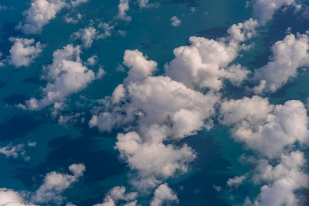 Flying above the earth and above the clouds in the territory of singapore. airplane window view. the plane flies in the sky above the earth.