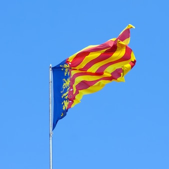 Flying flag of the valencian community
