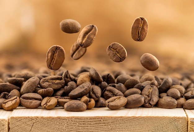 Flying fresh coffee beans as a background with copy space